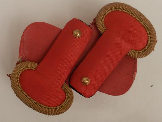 Gold and red epaulettes