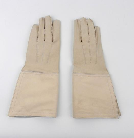 Pale yellow leather gloves