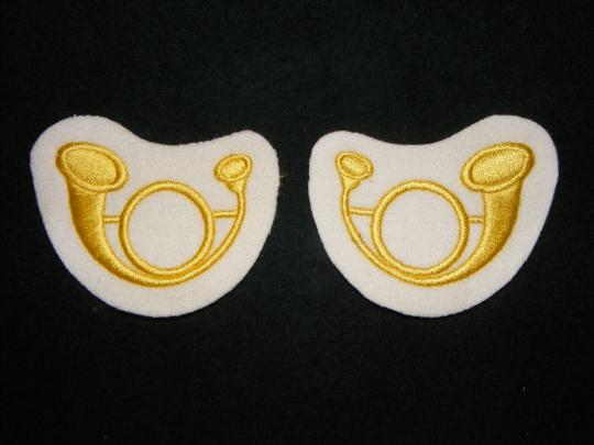 Horns for turnback ornaments, yellow on white, machine made, price by pair!