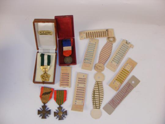 6 crosses sold together:2 croix de guerre 1939, 2 civilian decorations and ribbons for buttonholes.